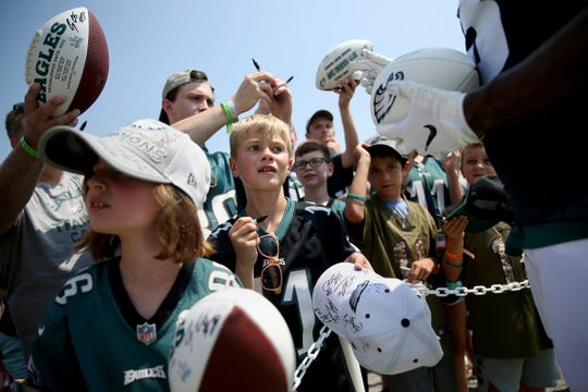 Ty Miller, 9, of Kennett Square, Pa., waits for an autograph from wide receiver Nelson Agholor after Eagles training camp at the NovaCare Complex in South Philadelphia on Saturday, July 27, 2019.