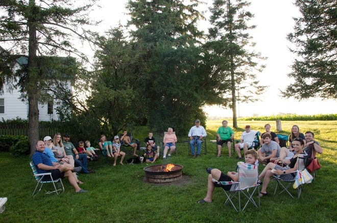 Three generations circle the campfire during Camp Manzke 2019.