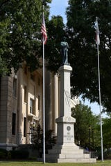 A Confederate statue stands outside the courthouse in Greenville, N.C.