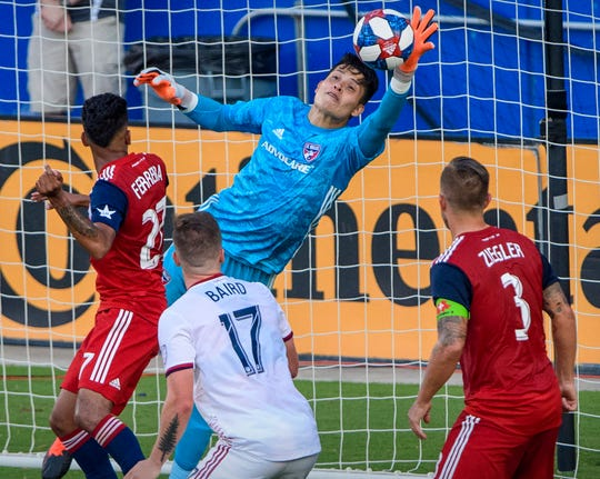 July 27: FC Dallas goalkeeper Jesse Gonzalez makes a save as forward Jesus Ferreira (27) and defender Reto Ziegler (3) defend against Real Salt Lake forward Corey Baird (17) during the first half at Toyota Stadium. The game ended in a 0-0 tie.