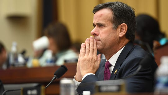 Rep. John Ratcliffe, R-Texas, listens as former special counsel Robert Mueller testifies in Washington, July 24, 2019.