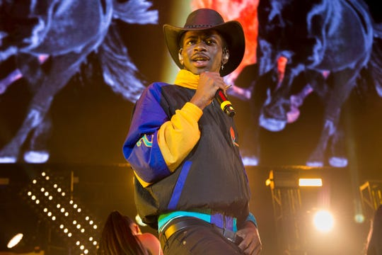"FILE - This June 1, 2019 file photo shows Lil Nas X performing at HOT 97 Summer Jam 2019 in East Rutherford, N.J. The rapper's viral ""Old Town Road"" has broken the Billboard record set by Mariah Carey's ""One Sweet Day"" for most weeks at No.1. (Photo by Scott Roth/Invision/AP, File) ORG XMIT: NYET104"