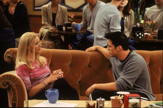 """Friends"" friends Phoebe (Lisa Kudrow) and Joey (Matt LeBlanc) hang out on that orange couch in Central Perk. Now you can, too."