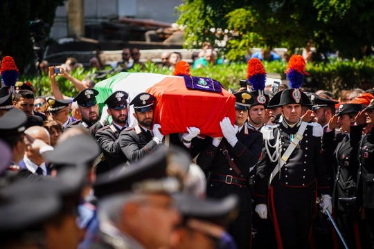 Carabinieri officers carry the Italian flag draped coffin containing the body of officer Mario Cerciello Rega during his funeral in his hometown of Somma Vesuviana (Naples), southern Italy, 29 July 2019.