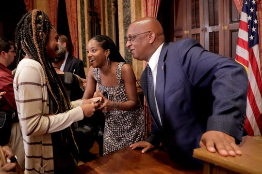 "Baltimore Mayor Bernard ""Jack"" Young speaks with Destane Peace, left, and Kashawna Duncan, after a news conference in Baltimore on  July 2, 2019."