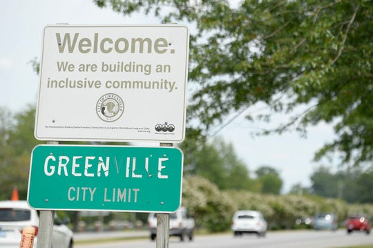 "A welcome sign in Greenville, N.C., reads, ""We are building an inclusive community."""