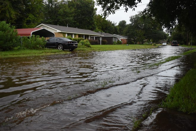 Waters that covered streets like Kimberly Street off the neighborhoods off Prescott Road began receding Tuesday afternoon.