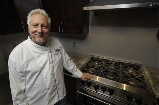 Private chef Ken McNamee poses for a photo in Seattle. McNamee has cooked in exclusive clubs around the world, yet he's sometimes overwhelmed by the scale of wealth around Seattle.