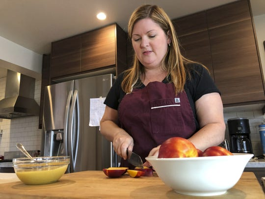 """Personal chef Melissa Furano Winstead bakes a nectarine galette for a client in San Francisco. One of the fastest-growing job categories of the past decade has been in what economists call """"wealth work"""": Catering to the whims, desires and appetites of the wealthy."""