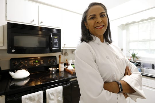 Sabrina Gallon, owner and principal culinarian of Good Fork Catering Co., poses for a photo in her home kitchen in Atlanta. Gallon is a personal chef and caterer who often prepares ingredients and equipment at home before going to work in customers' kitchens.