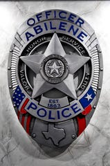 A large Abilene Police Department badge hangs on the wall in the lobby of the new Law Enforcement Center July 26.