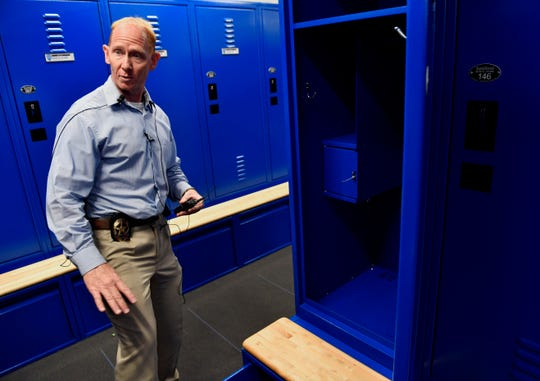 Assistant Police Chief Doug Wrenn leads a tour the new Law Enforcement Center through the locker room July 26. The former Kmart on South First Street will become the new home of the Abilene Police Department this year after a $24 million remodel.