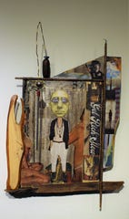 """A 2011 piece titled """"Get Rich Show"""" shows how artist Anthony Huff can assemble different objects to create a singular message. It's mixed media on wood. The green guy is Huff; his image, sans beard, shows up in several exhibition pieces."""