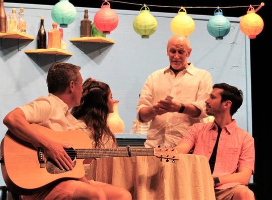 "Harry (Rob Davidson, with guitar), Sophie (Bailey Hafner) and Bill (Luke Palmer, right) listen to Sam (Doug LoPachin) consider why he and the other two men have been invited to her wedding  in this rehearsal scene from ""Mamma Mia!"", this summer's musical at the Huff Performing Arts Center at Clyde High School. July 29, 2019"