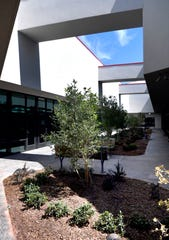 Sunlight shines onto a courtyard at the new Law Enforcement Center July 26.