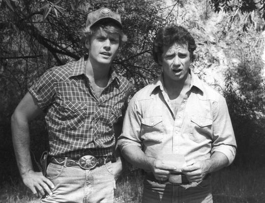"John Schneider, left, as Bo Duke and Tom Wopat as Luke in ""The Dukes of Hazzard."""