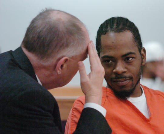 Shawn Brown confers with his attorney, James Goulooze before a hearing in 2010.