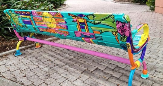Jennfier Gallo's backside of her beach-side hut inspired bench which was painted in 2017 and sponsored by Woodchucks Tree & Stumps.