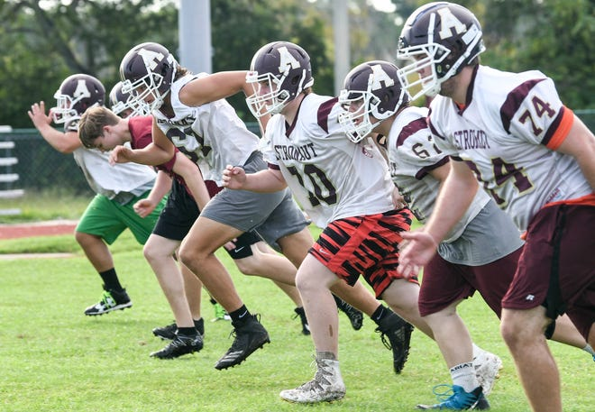 Astronaut High football players run drills during 2019 preseason practice at the school.