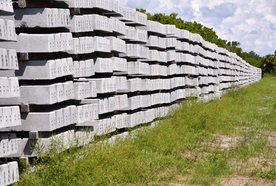 Thousands of Virgin Trains USA concrete railroad ties are stacked near State Road 524 and Industry Road in Cocoa.