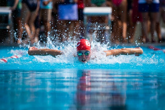 Cassie Woodson (BTC) swims the butterfly at the Champlain Valley Swim League Championships at Middlebury Municipal Pool in Middlebury on Saturday .
