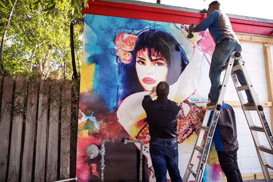 Ray Hernandez (clockwise from bottom left), David Dominguez and Alex Rodriguez, with Iconic Signs Group instal a new Selena mural on the exterior of the Food Store on Elvira Drive in the Molina neighborhood on Tuesday, July 30, 2019. The previous mural was painted by West Oso High School students in 1995 as a neighborhood tribute to Selena Quintanilla-Perez.