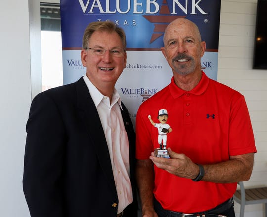 Credit Olivia Rook/Corpus Christi Hooks. Image: ValueBank Texas President and CEO Scott Heitkamp (left) with Ken Schrom (right) holding his bobblehead.