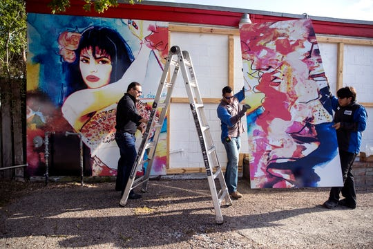 Ray Hernandez (from left), David Dominguez and Alex Rodriguez, with Iconic Signs Group instal a new Selena mural on the exterior of the Food Store on Elvira Drive in the Molina neighborhood on Tuesday, July 30, 2019. The previous mural was painted by West Oso High School students in 1995 as a neighborhood tribute to Selena Quintanilla-Perez.