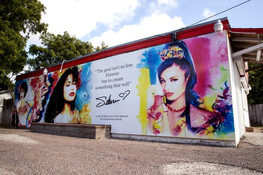 This new Selena mural by San Siguenza was installed on the exterior of the Food Store on Elvira Drive in the Molina neighborhood on Tuesday, July 30, 2019. The previous mural was painted by West Oso High School students in 1995 as a neighborhood tribute to Selena Quintanilla-Perez.