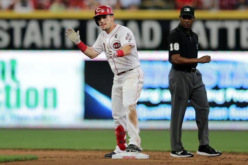 Cincinnati Reds second baseman Scooter Gennett (3) celebrates after hitting an RBI double in the second inning of an MLB baseball game against the Pittsburgh Pirates, Monday, July 29, 2019, at Great American Ball Park in Cincinnati.