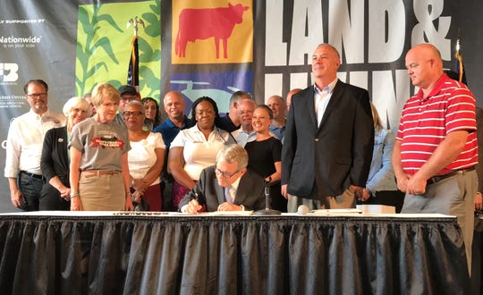 Gov. Mike DeWine signed a bill legalizing hemp and CBD in Ohio on Tuesday, July 30, 2019.