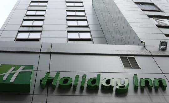 FILE - In this file photo dated March 28, 2019, the sign for a Holiday Inn in New York. The fight to save the seas from plastic waste may mean the end for mini bottles of shampoo and other toiletries, after the owner of Holiday Inn and InterContinental Hotels announced Tuesday July 30, 2019, that it will switch to bulk-size bathroom amenities across the hotel group.