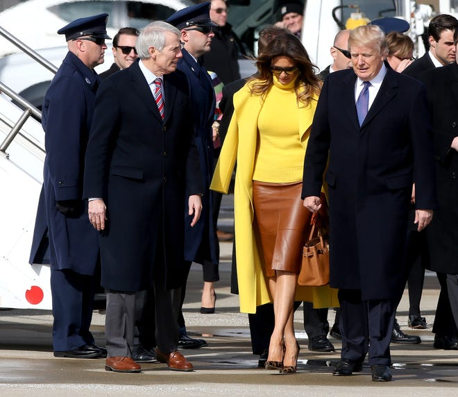 Senator Rob Portman, left, First Lady Melania Trump and President Donal at Lunken Airport Monday February 5, 2018.