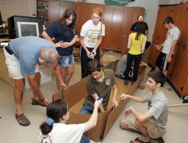 Flashback: Paul Mittura's Advance Placement physics summer enrichment class works on a cardboard boat at Clarksville High School on July 13, 2010.