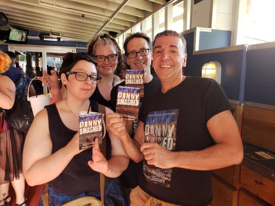 "Celebrating with friends, Greg Mantore  of Flemington (back right) and his writing partner Tony Sawicki (Front right) recently published their first novel, ""Danny Smashed."""