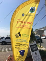 A Clean Communities banner waves in the wind on the Raritan Bay waterfront in Perth Amboy, as the city hosted a statewide Clean Communities event in the spring.
