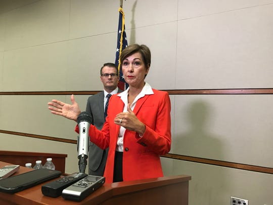 Gov. Kim Reynolds speaks to reporters during a news conference in Des Moines on Tuesday, July 30, 2019.