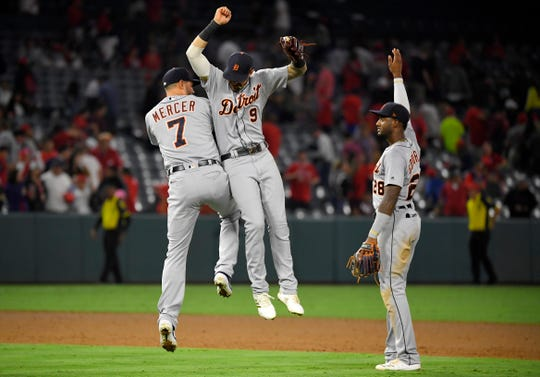 Tigers shortstop Jordy Mercer, left, celebrates with right fielder Nicholas Castellanos, center, and second baseman Niko Goodrum after the Tigers' 7-2 win over the Angels on Monday, July 29, 2019, in Anaheim, California.