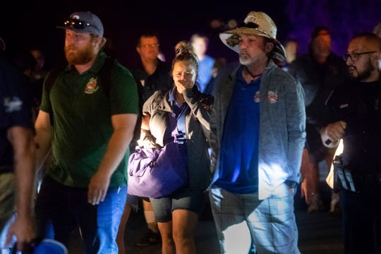 Police officers escort people from Christmas Hill Park following a deadly shooting during the Gilroy Garlic Festival, in Gilroy, Calif., on Sunday.