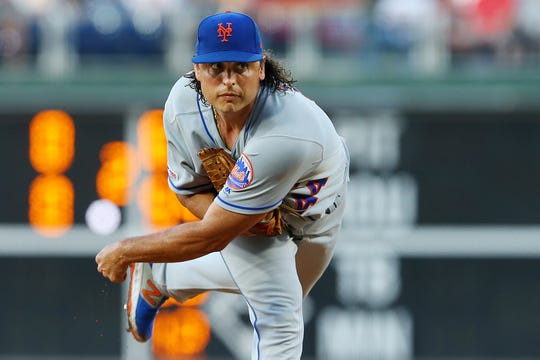 The Phillies qcquired left-hander Jason Vargas from the New York Mets on Monday for Double-A catcher Austin Bossart.