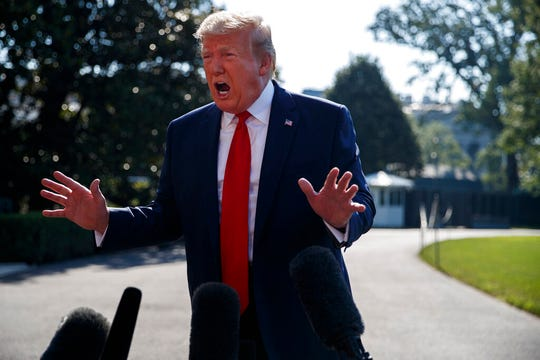 "President Donald Trump talks with reporters before departing for an event to celebrate the 400th anniversary celebration of the first representative assembly at Jamestown Tuesday, July 30, 2019, in Washington. ""I am the least racist person there is anywhere in the world,"" Trump told reporters."