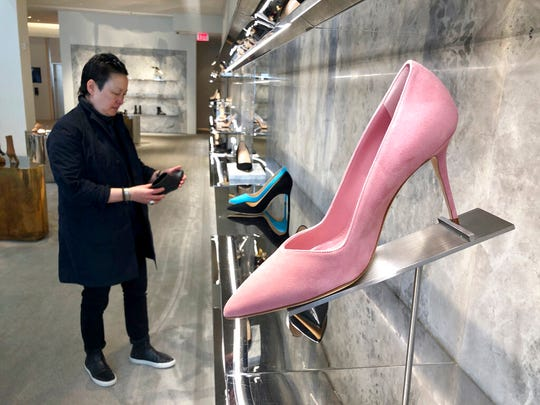 Personal shopper and stylist Kat Yeh looks at shoes for a client in San Francisco.