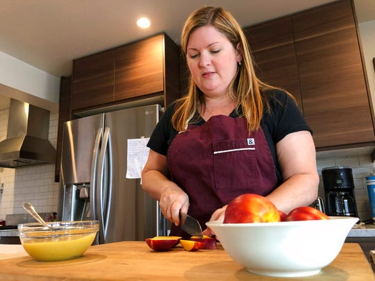Personal chef Melissa Furano Winstead bakes a nectarine galette for a client in San Francisco.