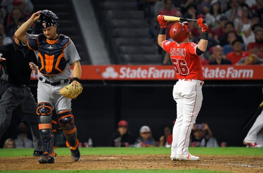 Los Angeles Angels' Kole Calhoun, right, reacts after striking out with the bases loaded as Tigers catcher John Hicks walks away during the sixth inning.