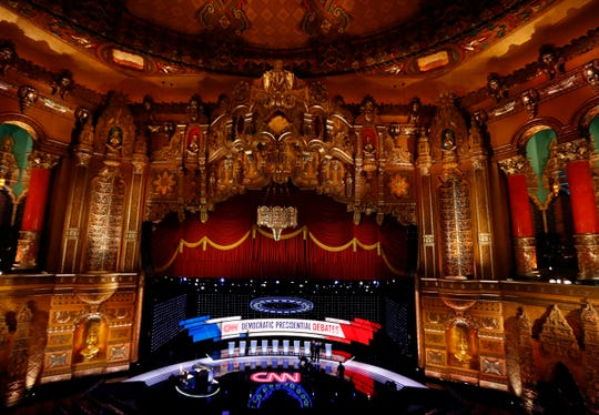 Workers get the stage ready for the Democratic presidential primary debate, Tuesday, July 30, 2019, at the Fox Theatre in Detroit.