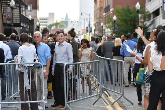 People stand in line to enter the Fox Theatre before the Democratic presidential debate at the Fox Theatre in Detroit.