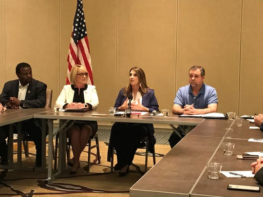 Republican National Committee Chairwoman Ronna McDaniel (center) speaks to attendees at a Detroit roundtable Tuesday, July 30, 3019, to discuss President Donald Trump's proposed U.S.-Mexico-Canada agreement. She was joined by several legislators and Michigan Republican Party Chairwoman Laura Cox (left) and co-chair Terry Bowman (right).