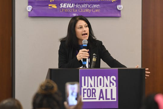 Attorney General Dana Nessel addresses nursing home workers to demand accountability and push for policies to address fair wages and safe staffing ensured to provide higher levels of care for nursing home residents.