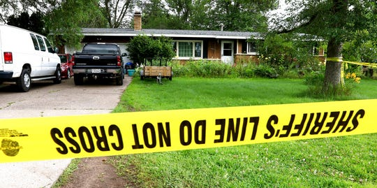 Police tape blocks off a home Monday, July 29, 2019, in Lake Hallie, Wis., following a shooting the night before. Authorities in northwestern Wisconsin say shootings at two homes have left five people dead, including the suspected shooter, and two others injured.