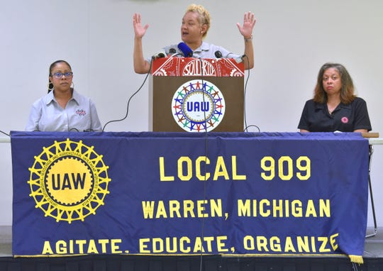 "Ahead of this week's shuttering of the GM's Warren Transmission plant, UAW Local 909 member Regina Duley, center, of Oak Park, address the media as she holds up her hands and says, ""These are working hands."""